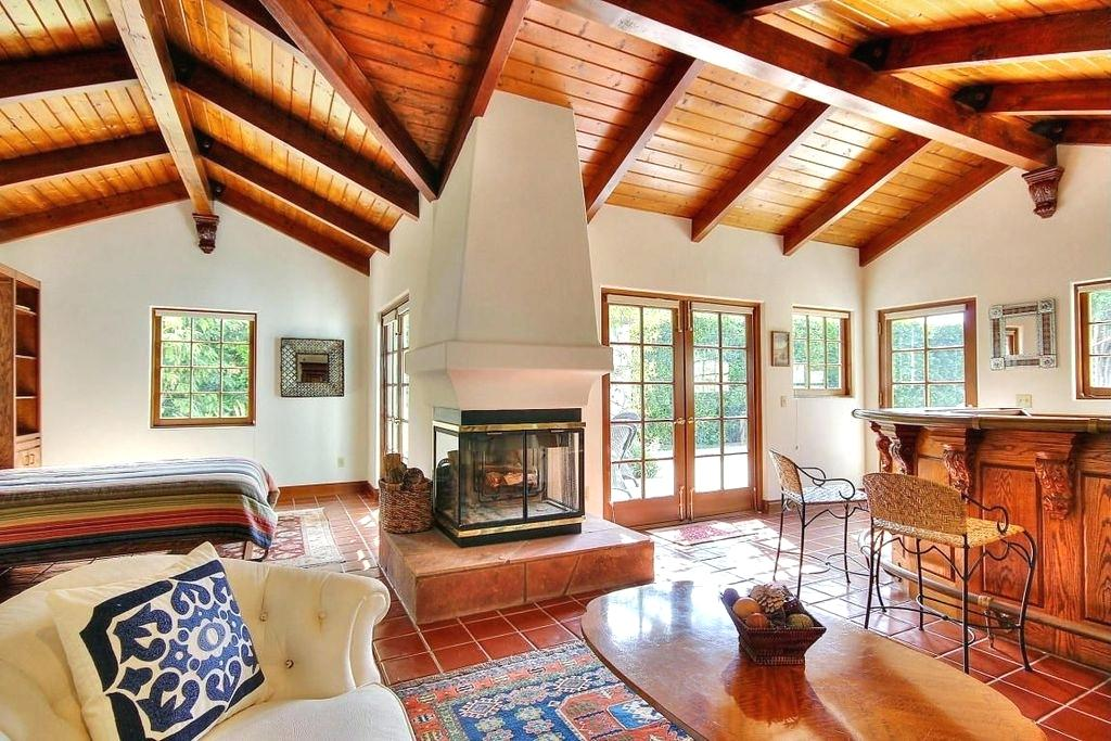 exposed beams images master bedroom with pine ceiling high ceiling terracotta tile floors metal fireplace exposed ceiling beams images