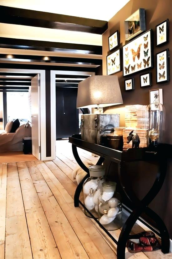 light hardwood floors with dark furniture butterfly display dark furniture and accent wall light colored wood floors light hardwood floors dark furniture
