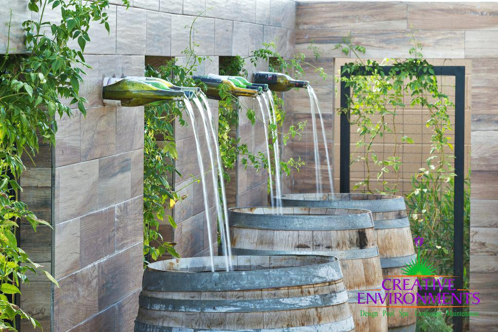 rustic landscaping ideas 2 tags contemporary landscape yard with fountain fence whiskey barrel trellis