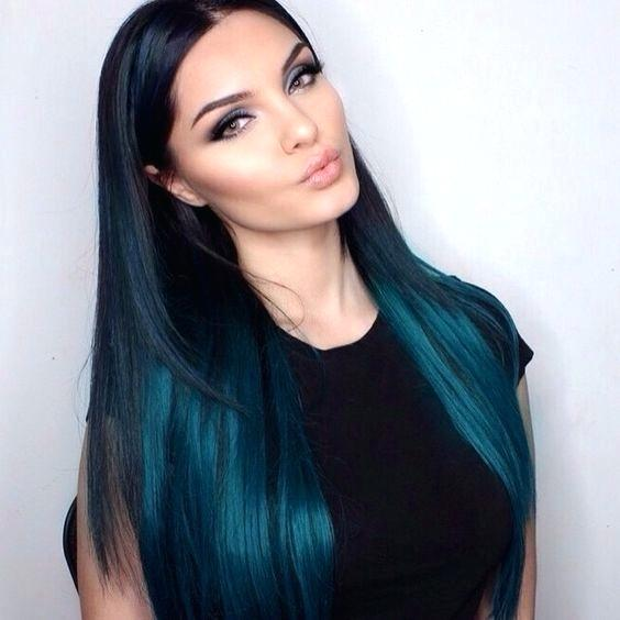 shades of teal hair with a dark teal applied throughout hairs lower layers and a pure black shade higher up this layered look lets you wear a ton of teal hair without the blue teal hair dye