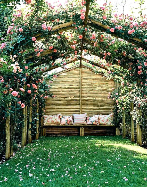 trellis next to house a natural wood trellis bedecked in climbing roses creates the perfect space for an