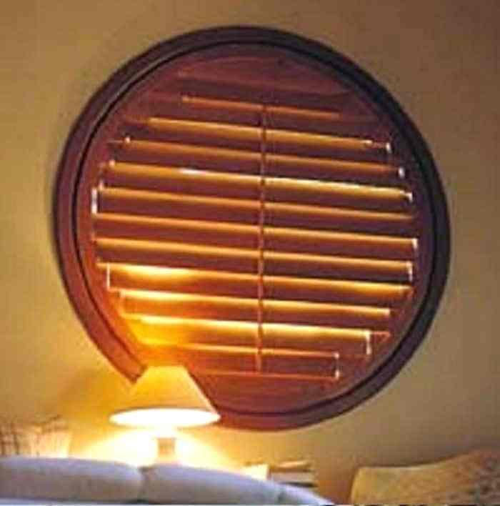 circular window blinds round window with wooden shutter