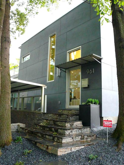 contemporary metal awnings example of a minimalist metal exterior home design in