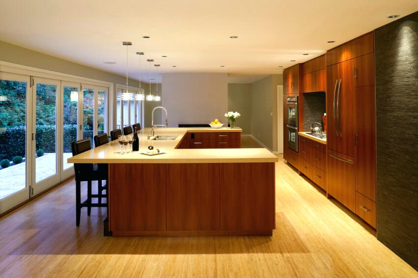 light hardwood floors wall color this clean cut kitchen is brightened by the light wood floor and matching