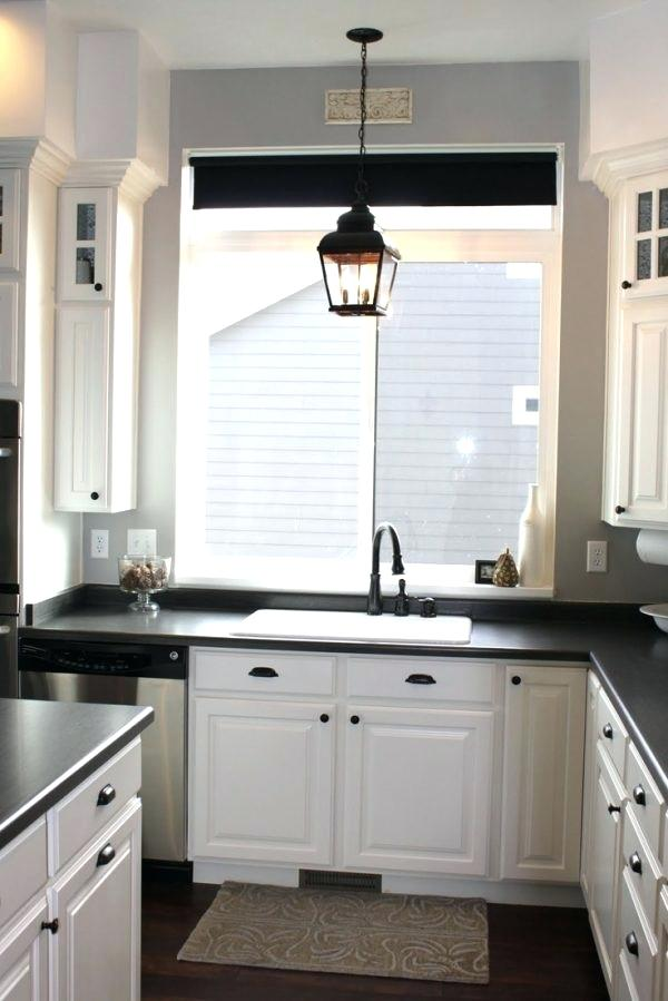 over the kitchen sink lighting ideas above kitchen sink lighting ideas using candle shaped led bulbs inside pendant lantern light fixtures also
