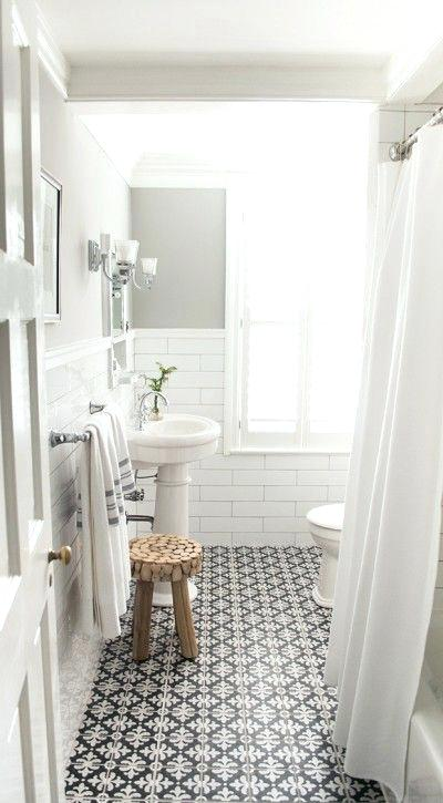 white subway tile bathroom bathroom with white subway tile and patterned floor tiles designed by vintage scout interiors